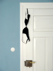 bra hanging on door