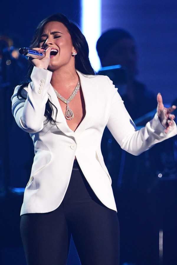 Demi Lovato belting a tune at the Grammys