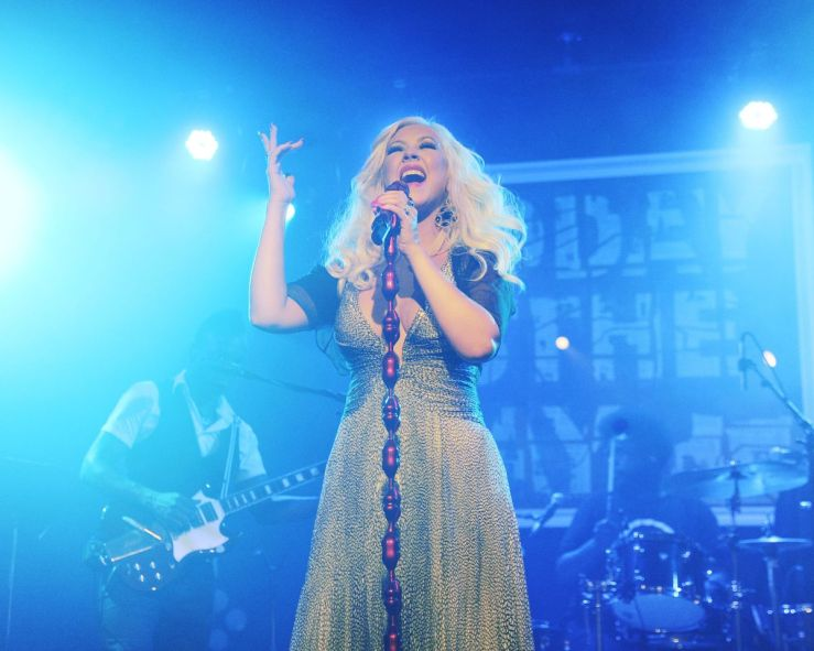 Christina Aguilera belting out a tune on stage