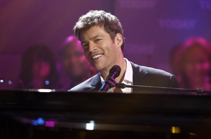 Harry Connick Jr playing piano and smiling